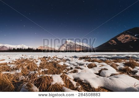 Just Outside Of The Town Of Banff, These Lakes Offer Spectacular Views Of The Iconic Mt. Rundle And