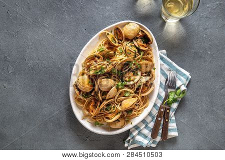 Seafood Pasta. Italian Spaghetti Alle Vongole. Clams Spaghetti On White Plate With White Wine, Gray