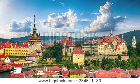 Panoramic Summer View Over The Medieval Cityscape Architecture In Sighisoara Town, Historical Region