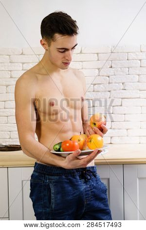 proper nutrition, motivation, fitness, vegetarian, paleo diet. fit sporty man with perfect muscle body eating healthy food poster