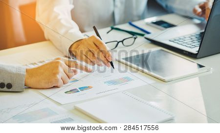 Businessman Investment Consultant Analyzing Company Financial Report Balance Sheet Statement Working