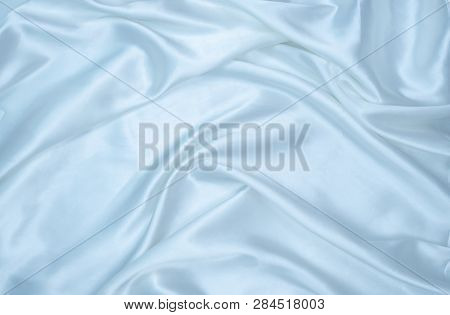 White Smooth Satin Or Silk Texture Background. Elegant Cloth Material Textiles. White Fabric Abstrac