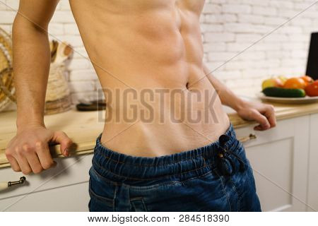 proper nutrition, motivation, fitness, healthy lifestyle, diet. fit sporty man with perfect muscle body at home kitchen poster