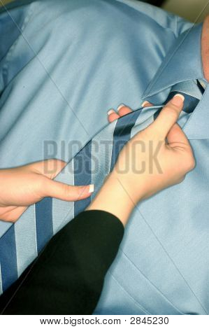 Woman Adjusting Tie