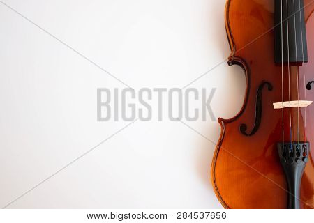 Violin with bow in white background or fiddle in white background