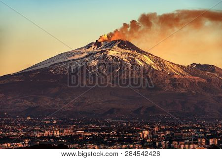 Mount Etna Volcano With Smoke At Dawn And The Catania City, Sicily Island, Italy, Europe