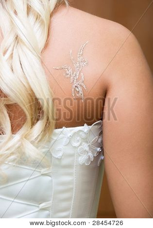 body-art on the back of a young bride