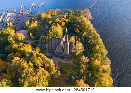 Aerial view of the church of Mary Magdalene in the golden autumn (aerial photography). Primorsk, Leningrad Region poster