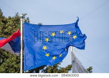 Waving Flag Of Europe With Emblem Of Yellow Stars On Blue, Council Of Europe And European Union, Clo