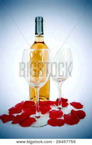 Glasses, Bottle Of Wine And Rose Petals Composition