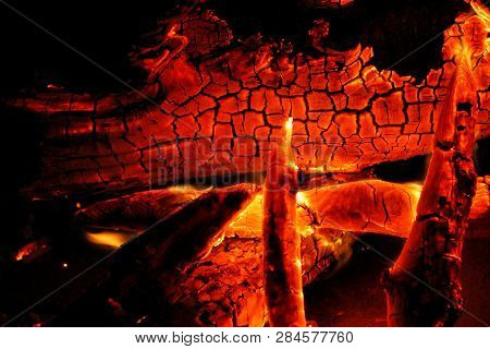 Burning Log Of Wood Close-up As Abstract Background. The Hot Embers Of Burning Wood Log Fire. Firewo