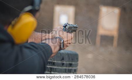 Shooting On Target In Shooting Range. Back Close-up Detail View