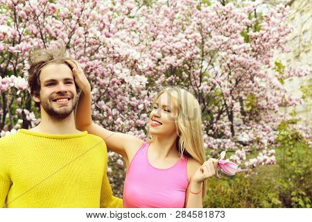Couple In Love. Happy Couple In Love In Spring Magnolia Flowers, Smiling Man And Girl In Garden With