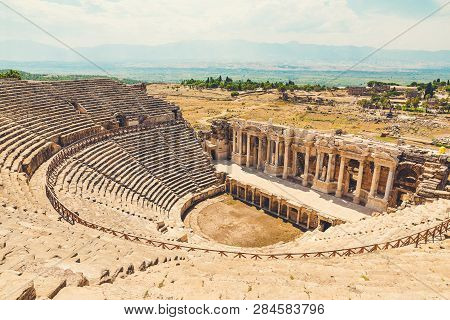 Panorama Ancient Greco Roman City. Ruins Of Ancient City Of Old Amphitheater, Hierapolis In Pamukkal