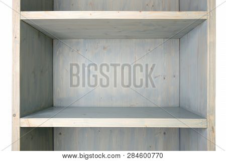 Empty blue wooden shelf isolated on white background. Wood shelf cupboard with grunge aging surface. poster