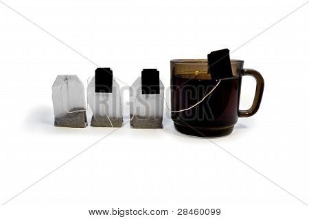 Three Tea Bags And A Cup Of Tea
