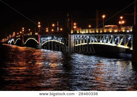 Illuminated Bridge At Night In St. Petersburg