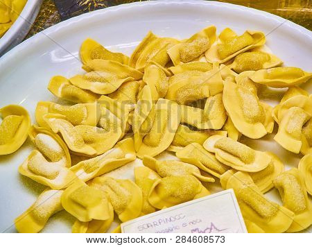 Homemade Scarpinocc Cheese And Nuts Fillings For Sale In A Shop. Fresh Stuffed Pasta Typical Of The