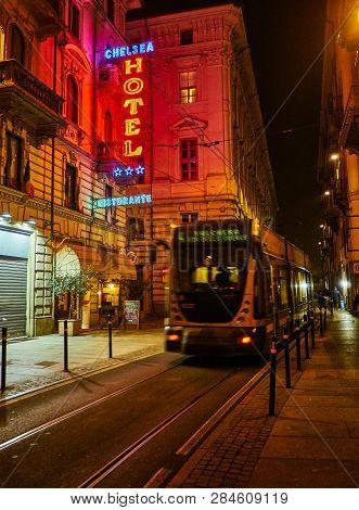 Turin, Italy - January 1, 2019. Hotel And Ristorante Neon Signboard In An Italian Street At Night Cr