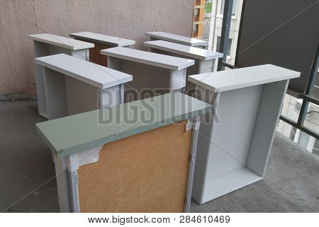 Painting The Drawers Of The Cabinet And The Bedside Tables From The Paint Can. In White Color. On Th