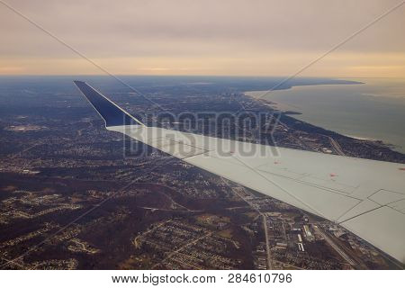 Winglet In Graduated Dark Blue Sky With A View Of Big City Below In Cleveland, Ohio.
