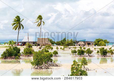 Village On South Tarawa Atoll, Kiribati, Gilbert Islands, Micronesia, Oceania. Thatched Roof Houses.