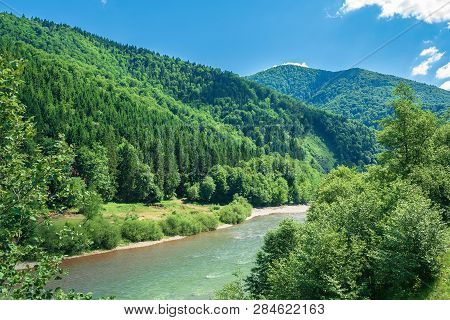 Forest River In Mountains. Forested Hill And Shore With Pebble Beach. Beautiful Summer Landscape At