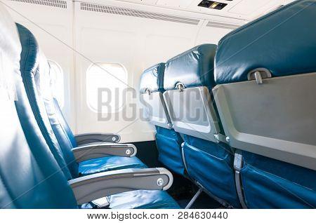 Empty Seats In A Passenger Plane. Passenger Plane Interior, Economy Class. Travel Concept