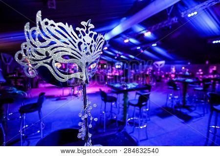 Silver Masquerade Mask As Decoration At Gala Dinner Event