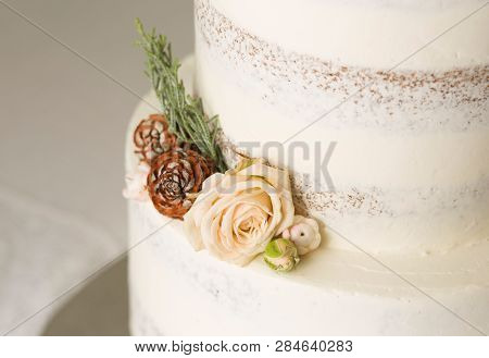 Closeup Picture About A Detail Of White Wedding Cake With Ornaments