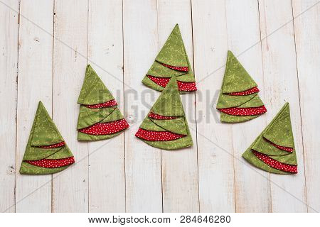 Patchwork, Quilting And Fashion Concept - Colorful Decorative Red-and-green Napkins On A Whitewashed