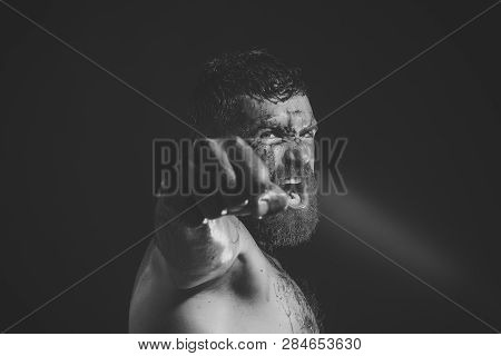 Bearded Man Show Bloody Fist On Black Background. Power, Might, Magic. Sport, Boxing, Fighting. Hips