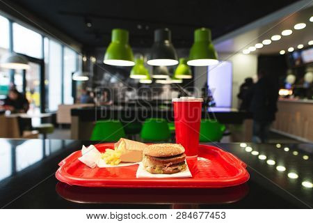 Fast Food Menu On The Table Tray At The Fast Food Restaurant. Burger, French Fries And A Glass Cola