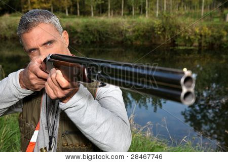 a hunter aiming for a target