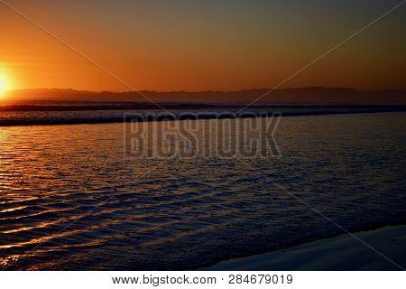 Dramatic Sunrise Colours; Beautiful Sunrise On A Beach.
