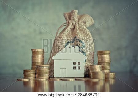 Planning Savings Money Of Coins To Buy A Home, Concept For Property Ladder, Mortgage And Real Estate