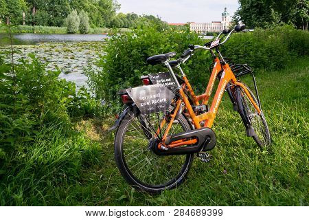 Berlin / Germany - 29 June 2018: Two Donkey Republic Rented Bicycles Parked Near A Lake In The Inter