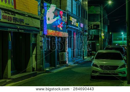 Dongducheon, South Korea; February 1, 2019:  Night View Of Cars Parked On Empty Street In Bosam-dong