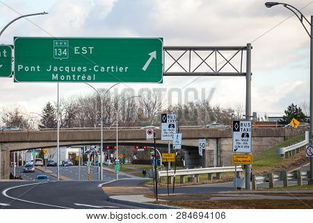 Montreal, Canada - November 8, 2018: Roadsign Indicating Jacques Cartier Bridge And The Direction Of