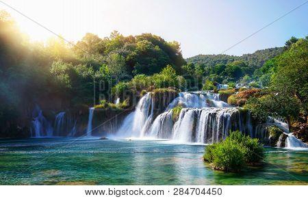 Panoramic Landscape Of Krka Waterfalls On The Krka River In Krka National Park In Croatia.