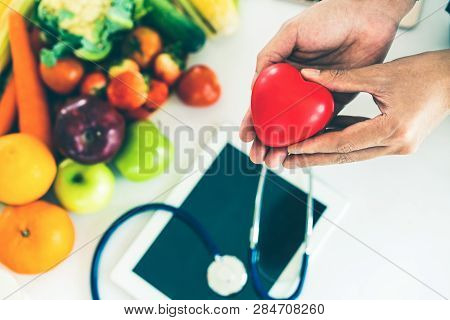 Diet Food Of Fruit And Vegetables For Cholesterol Control With Nutritionist Hands Showing Awareness