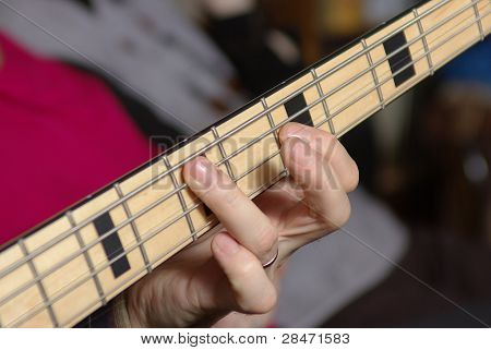 Man playing a bass guitar