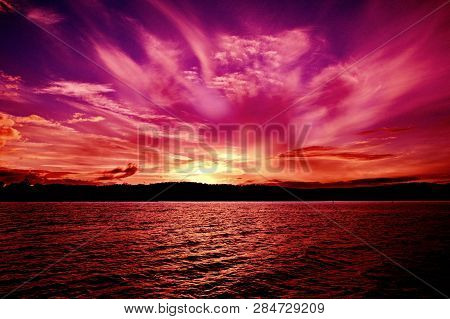 Spectacular Vivid Pink Magenta Cissus Cloudy Ocean Sunset With Water Reflections.  Photographed In L