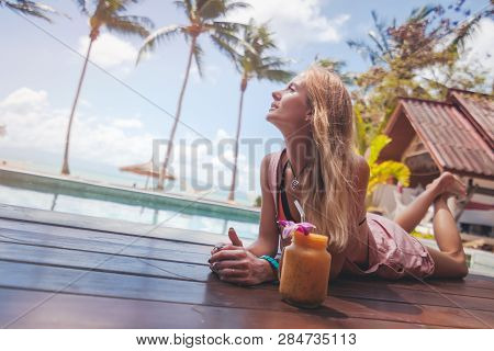 Preetty Blonde Woman Relaxing On Tropical Resort. Holiday, Vacation, Summer Beach Concept. Healthy L