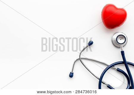 Heart Health, Health Care Concept. Stethoscope Near Rubber Heart On White Background Top View Copy S