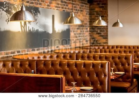 Interior Of Booth Style Restaurant Diner With Brown Interior