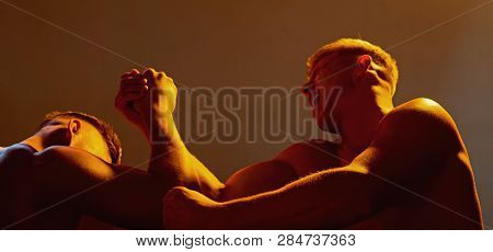 Strength Skills. Twins Men Competing Till Victory. Twins Competitors Arm Wrestling. Men Competitors