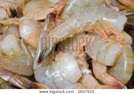 A large pile of headless shrimp ready to be cleaned. poster