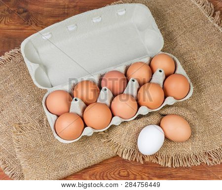 Top View Of Brown Chicken Eggs In Open Paper Pulp Carton For Ten Eggs, Brown And White Eggs Beside T