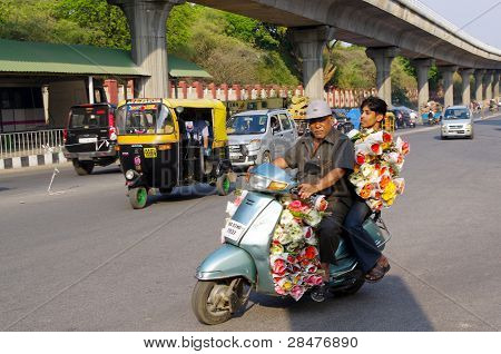 Man Delivering Flowers On Motorbike